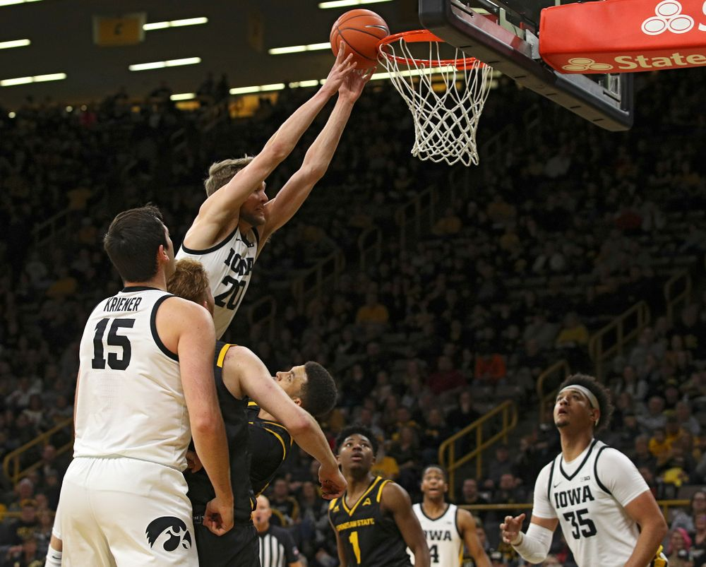 Iowa Hawkeyes forward Riley Till (20) is fouled as he tries to dunk over Kennesaw State Owls forward Bryson Lockley (24) during the second half of their their game at Carver-Hawkeye Arena in Iowa City on Sunday, December 29, 2019. (Stephen Mally/hawkeyesports.com)