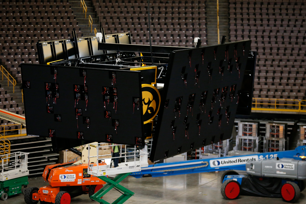 Workers raise the new centerhung video board