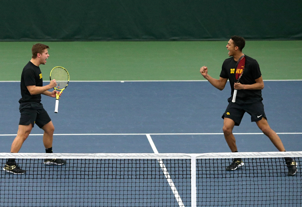 Iowa's Will Davies (from left) and Oliver Okonkwo celebrate a point during their doubles match at the Hawkeye Tennis and Recreation Complex in Iowa City on Friday, March 6, 2020. (Stephen Mally/hawkeyesports.com)