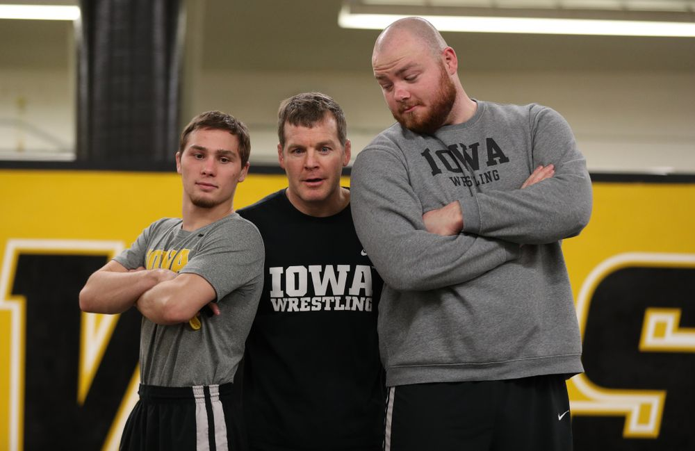 Iowa Hawkeyes head coach Tom Brands photobombs Spencer Lee and Sam Stoll during the team's annual media day Monday, November 5, 2018 at Carver-Hawkeye Arena. (Brian Ray/hawkeyesports.com)