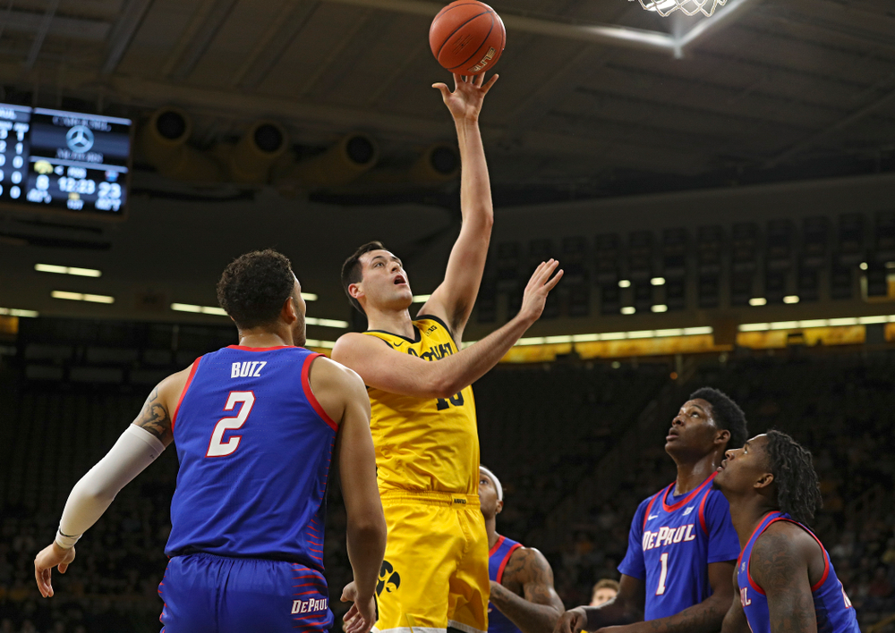 Iowa Hawkeyes forward Ryan Kriener (15) scores a basket during the first half of their game at Carver-Hawkeye Arena in Iowa City on Monday, Nov 11, 2019. (Stephen Mally/hawkeyesports.com)