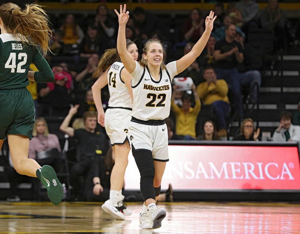 Iowa Hawkeyes guard Kathleen Doyle (22) holds up three fingers in each hand after guard Mckenna Warnock (14) made a 3-pointer during the fourth quarter of their game at Carver-Hawkeye Arena in Iowa City on Sunday, January 26, 2020. (Stephen Mally/hawkeyesports.com)