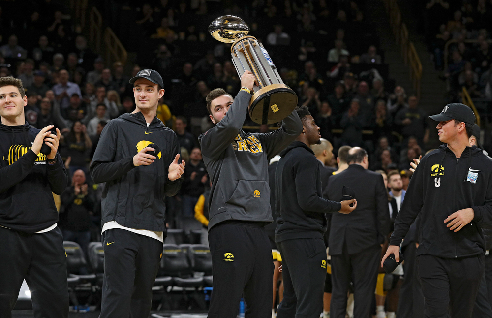 Iowa Hawkeyes punter Colten Rastetter holds up the 2019 Holiday Bowl trophy during a timeout in the first half of the game at Carver-Hawkeye Arena in Iowa City on Monday, January 27, 2020. (Stephen Mally/hawkeyesports.com)