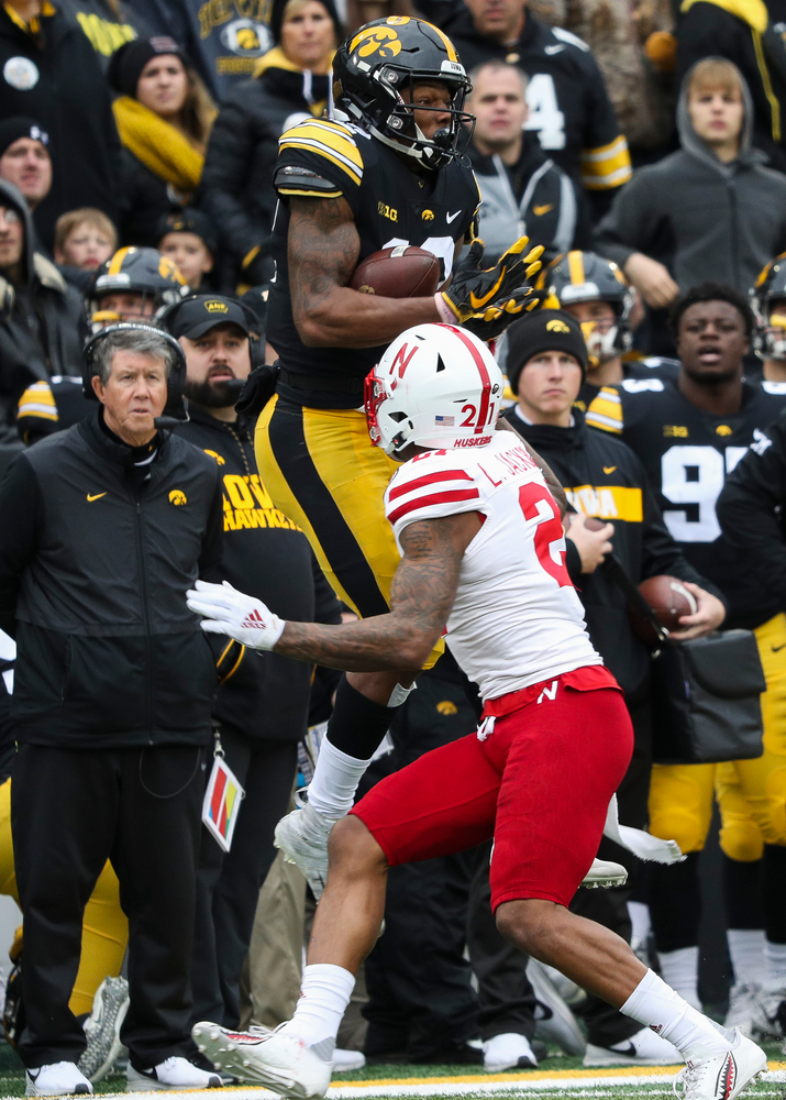 Iowa Hawkeyes wide receiver Brandon Smith (12) makes a first down reception during a game against Nebraska at Kinnick Stadium on November 23, 2018. (Tork Mason/hawkeyesports.com)