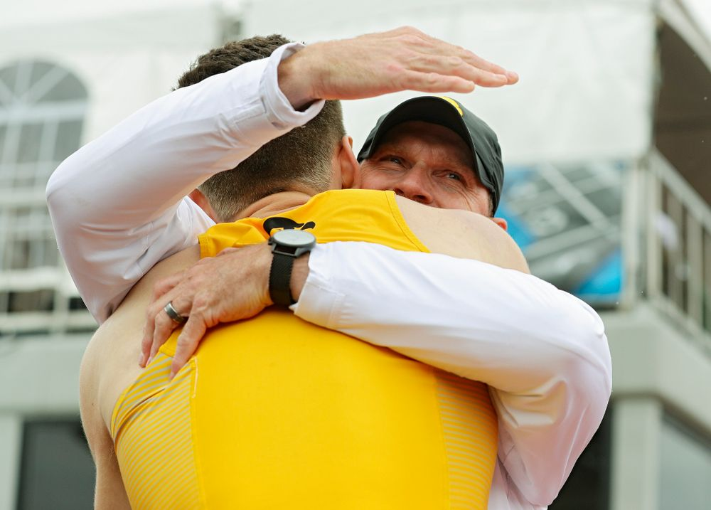 Iowa Director of Track and Field Joey Woody (right) hugs Chris Douglas after Douglas won the men's 400 meter hurdles event on the third day of the Big Ten Outdoor Track and Field Championships at Francis X. Cretzmeyer Track in Iowa City on Sunday, May. 12, 2019. (Stephen Mally/hawkeyesports.com)