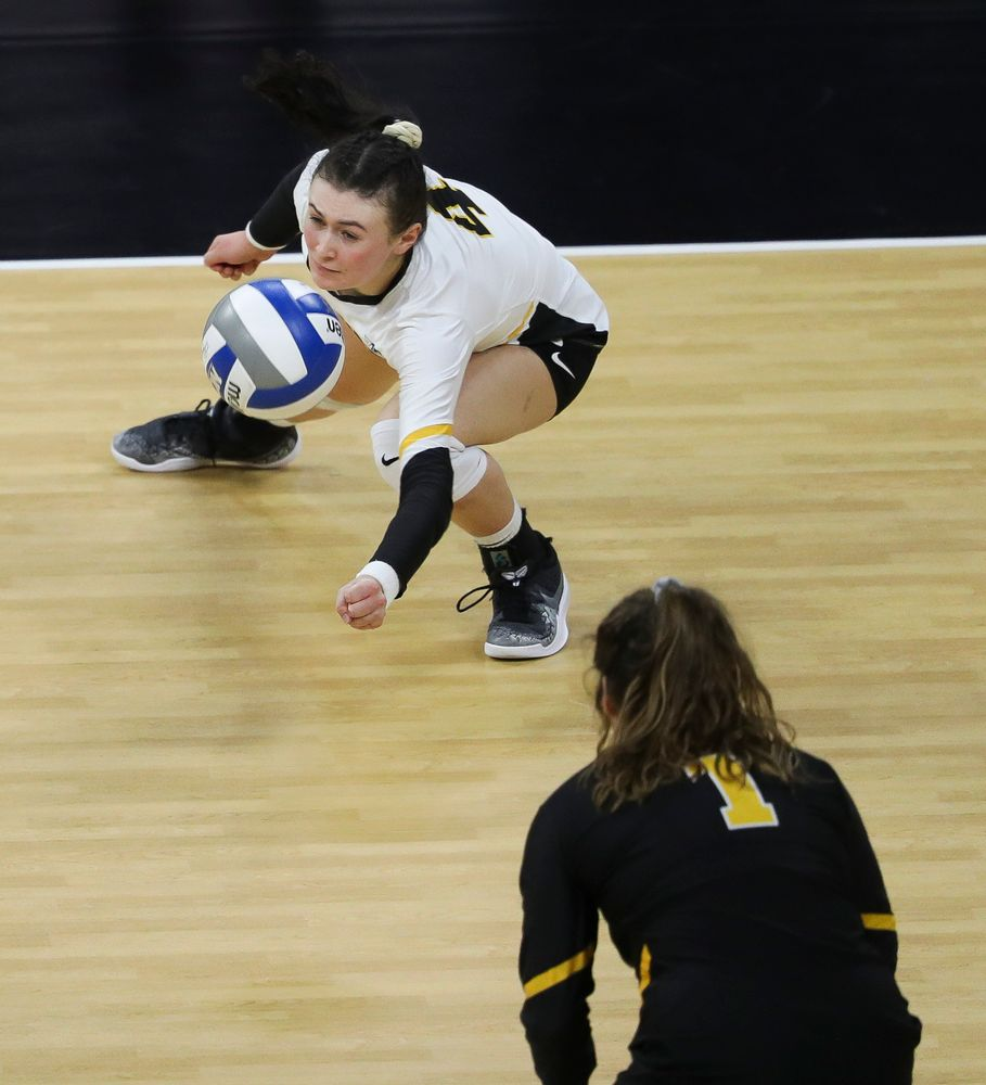 Iowa Hawkeyes defensive specialist Halle Johnston (4) digs the ball during a match against Penn State at Carver-Hawkeye Arena on November 3, 2018. (Tork Mason/hawkeyesports.com)