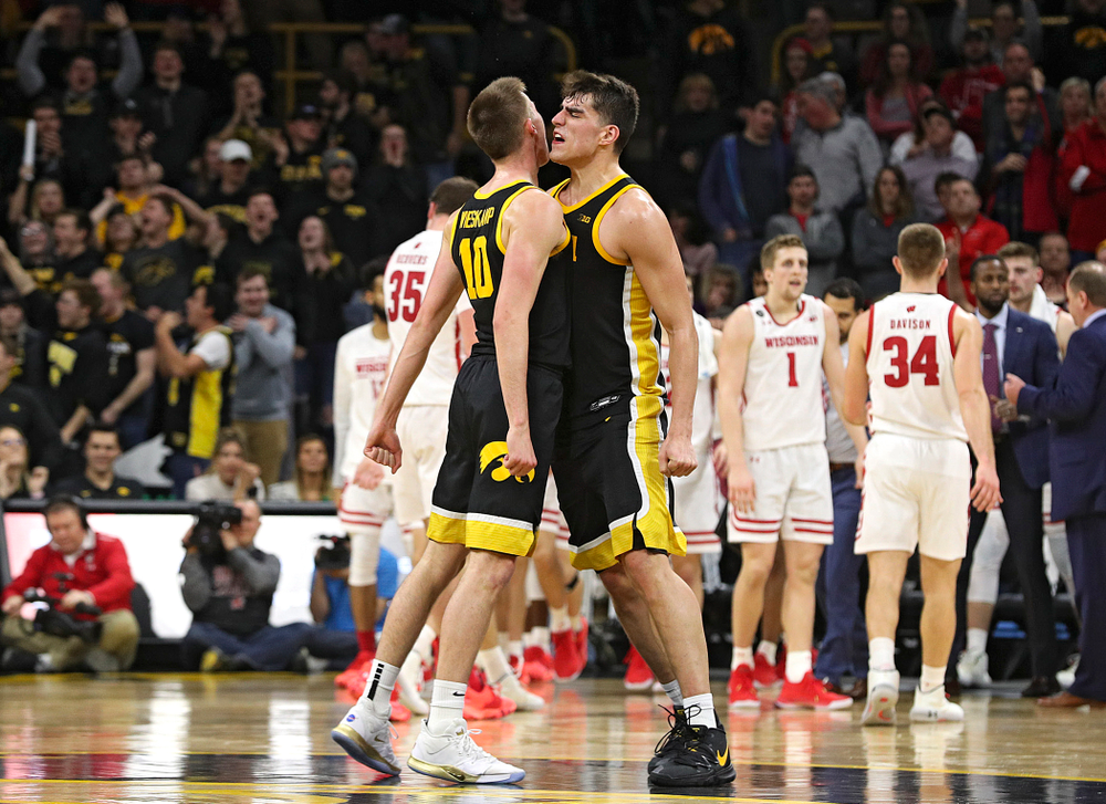 Iowa Hawkeyes guard Joe Wieskamp (10) and center Luka Garza (55) celebrate as they walk back to the bench for a timeout during the second half of their game at Carver-Hawkeye Arena in Iowa City on Monday, January 27, 2020. (Stephen Mally/hawkeyesports.com)