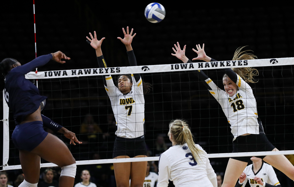 Iowa Hawkeyes setter Brie Orr (7) and Iowa Hawkeyes middle blocker Hannah Clayton (18) go up for a block during a match against Penn State at Carver-Hawkeye Arena on November 3, 2018. (Tork Mason/hawkeyesports.com)