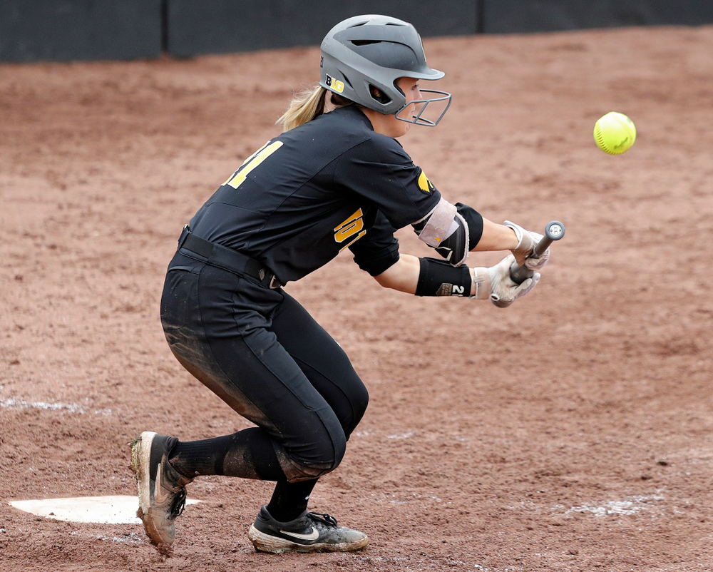 Iowa outfielder Havyn Monteer (21) lays down a bunt single during the fifth inning of their game against Iowa Softball vs Indian Hills Community College at Pearl Field in Iowa City on Sunday, Oct 6, 2019. (Stephen Mally/hawkeyesports.com)