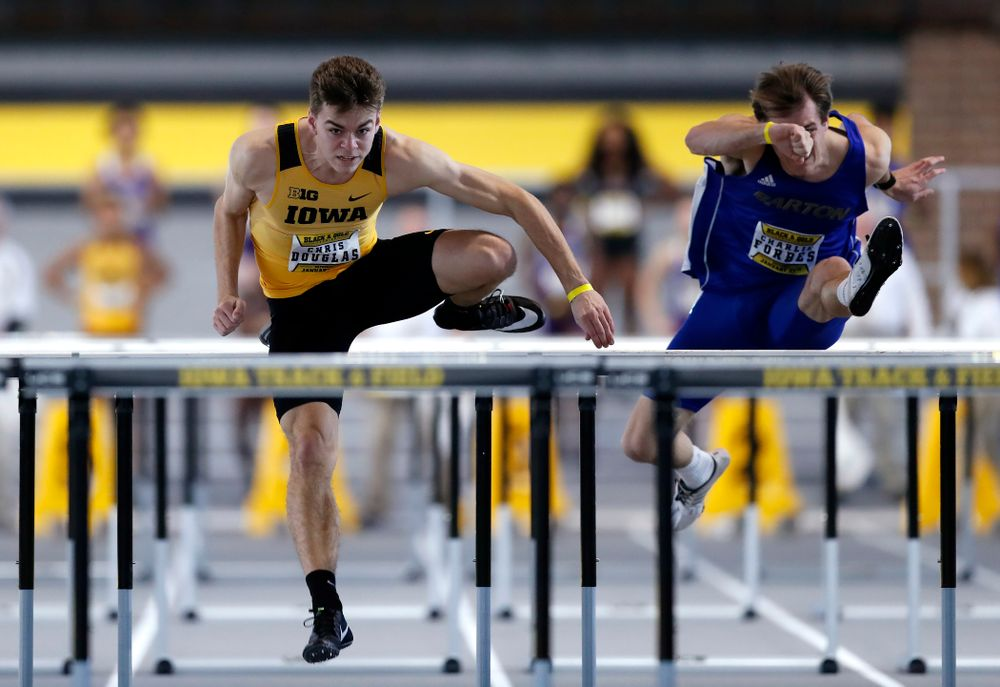 Chris Douglas competes in 60 meter high hurdles