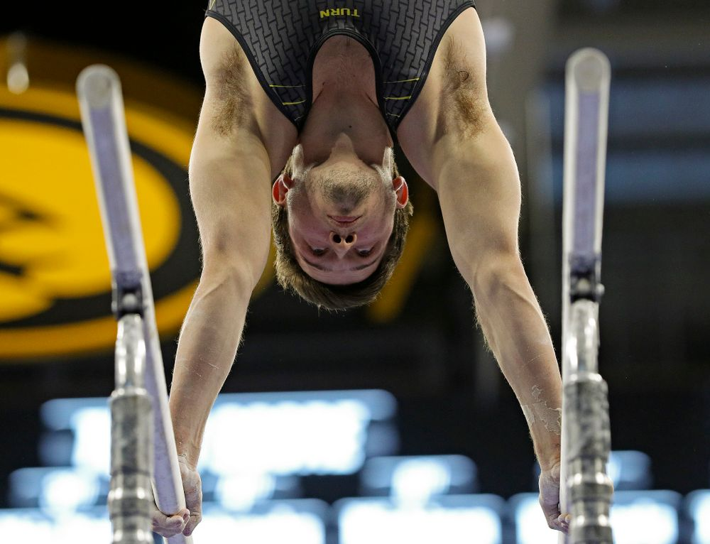 Iowa's Rogelio Vazquez competes in the parallel bars during the first day of the Big Ten Men's Gymnastics Championships at Carver-Hawkeye Arena in Iowa City on Friday, Apr. 5, 2019. (Stephen Mally/hawkeyesports.com)