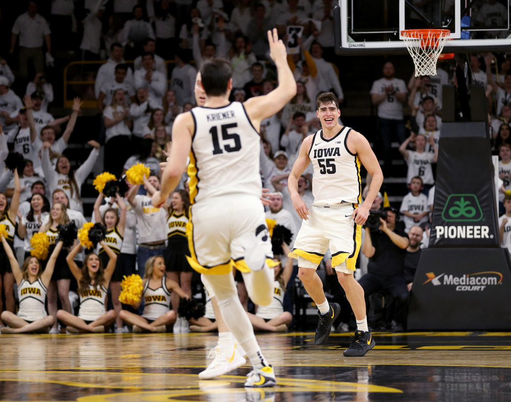 Iowa Hawkeyes forward Luka Garza (55) celebrates a three point basket against the Illinois Fighting Illini Sunday, February 2, 2020 at Carver-Hawkeye Arena. (Brian Ray/hawkeyesports.com)