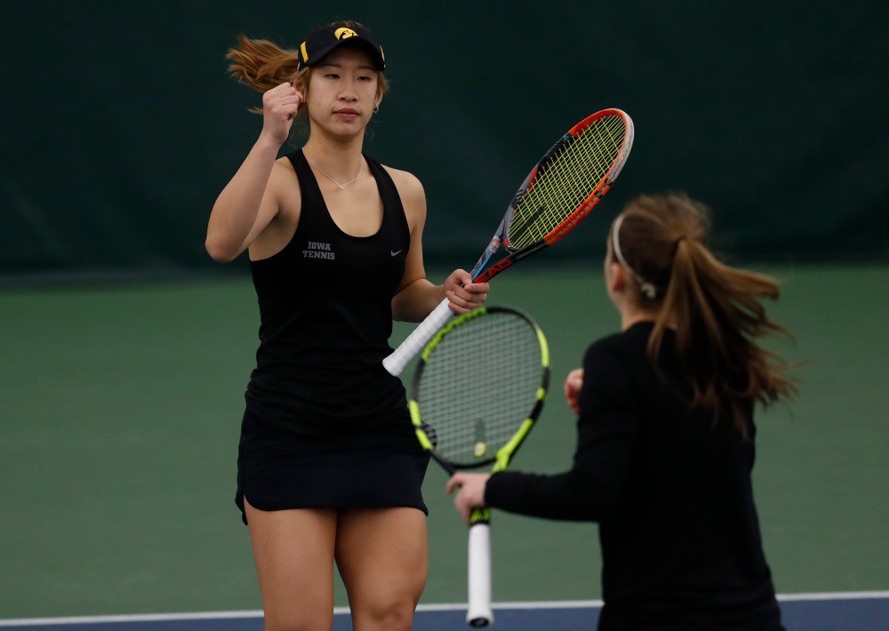 Iowa's Yufei Long and Zoe Douglas play a doubles match against Marquette