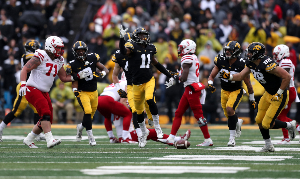 Iowa Hawkeyes defensive back Michael Ojemudia (11) celebrates after intercepting a pass against the Nebraska Cornhuskers Friday, November 23, 2018 at Kinnick Stadium. (Brian Ray/hawkeyesports.com)