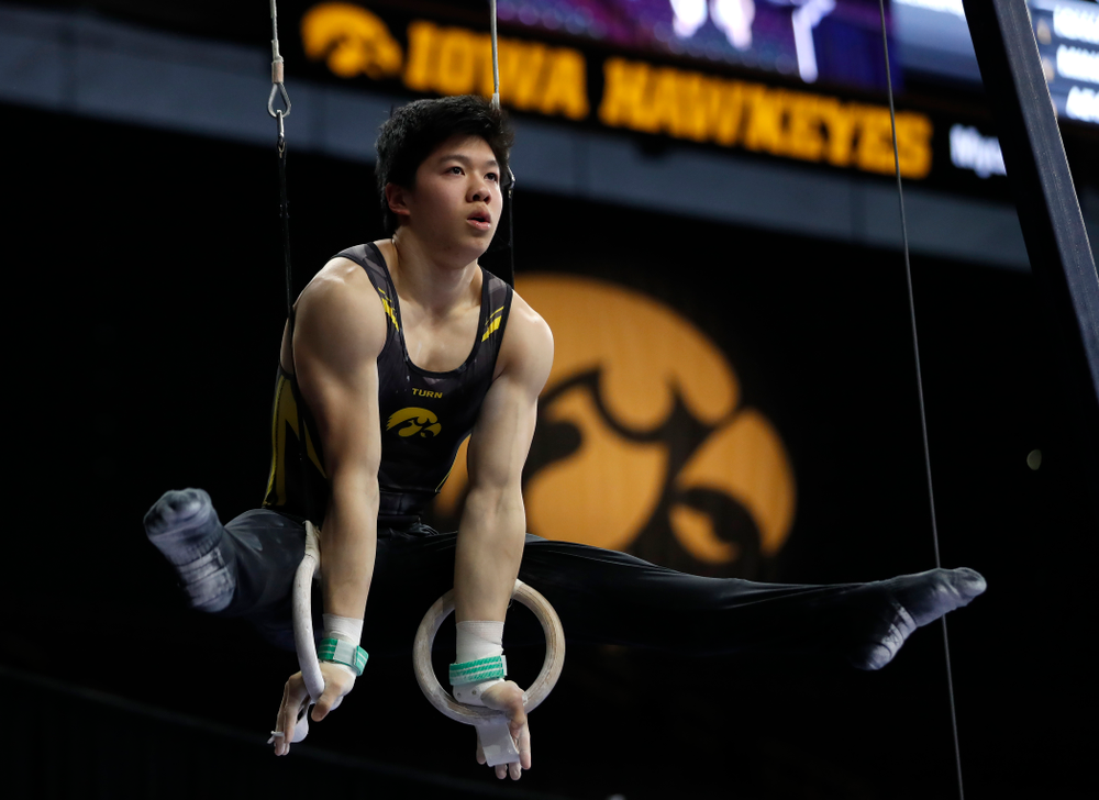 Bennet Huang competes on the rings against Minnesota and Air Force