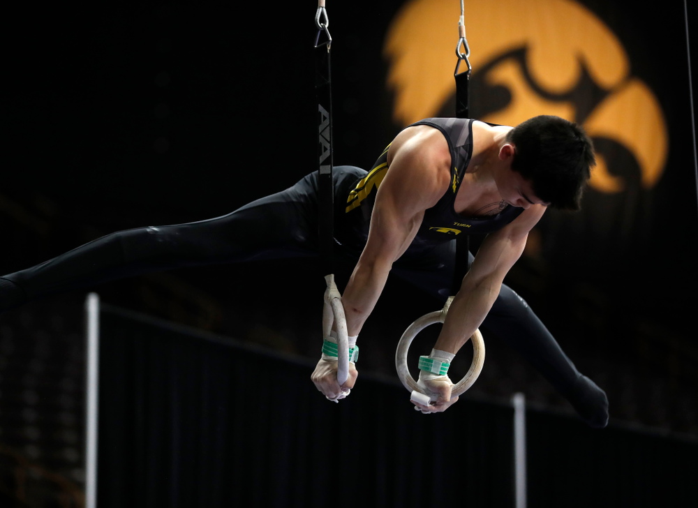Addison Chung competes on the rings against Minnesota and Air Force
