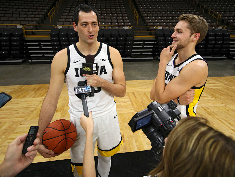 Iowa Hawkeyes forward Ryan Kriener (15) answers a question from forward Riley Till (20) during Iowa Men's Basketball Media Day at Carver-Hawkeye Arena in Iowa City on Wednesday, Oct 9, 2019. (Stephen Mally/hawkeyesports.com)