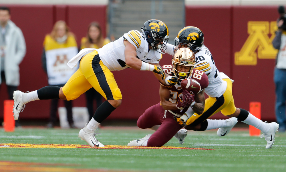 Iowa Hawkeyes defensive back Amani Hooker (27) and defensive back Julius Brents (20) break up a pass against the Minnesota Golden Gophers Saturday, October 6, 2018 at TCF Bank Stadium. (Brian Ray/hawkeyesports.com)