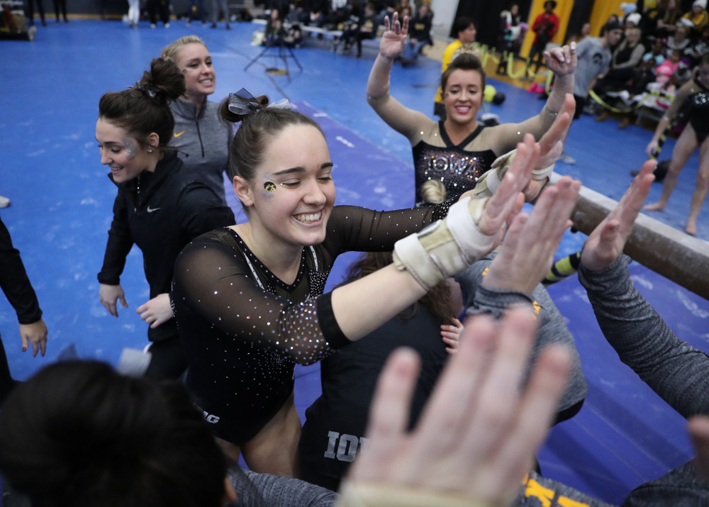 Iowa's Allie Gilchrist competes on the beam during the Black and Gold intrasquad meet Saturday, December 1, 2018 at the University of Iowa Field House. (Brian Ray/hawkeyesports.com)