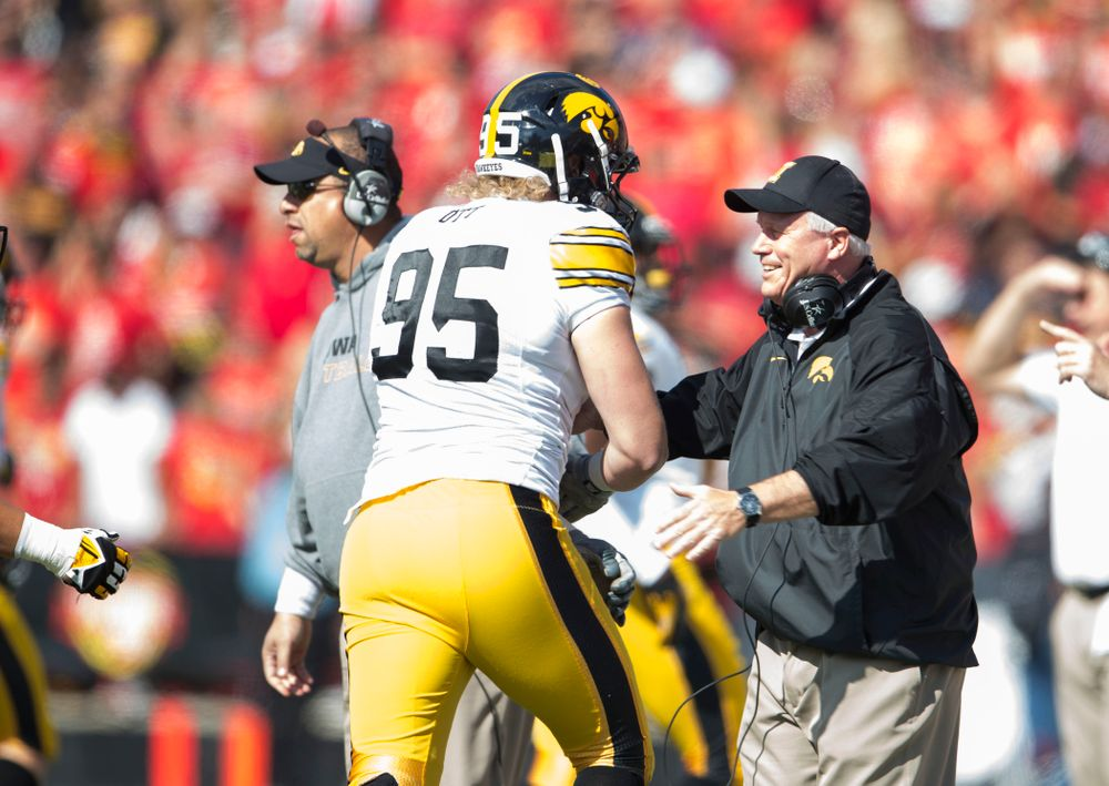 Iowa Hawkeyes defensive lineman Drew Ott (95) celebrates with defensive line coach Reese Morgan after intercepting a pass during the first half of their game Saturday, Oct. 18, 2014 at Byrd Stadium in College Park, Md.  (Brian Ray/hawkeyesports.com)