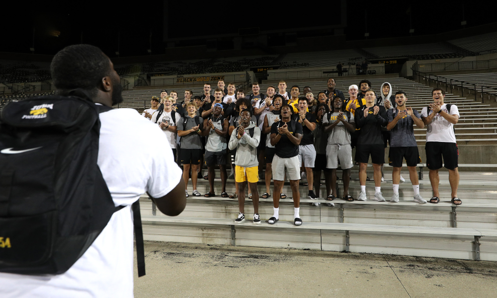 Iowa Hawkeyes defensive tackle Daviyon Nixon (54) leads the new players in a second rendition of the ÒFight SongÓ  Thursday, August 22, 2019 at Kinnick Stadium in Iowa City. (Brian Ray/hawkeyesports.com)