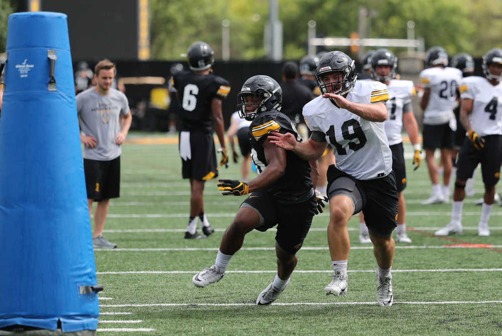 Iowa Hawkeyes running back Mekhi Sargent (10) and linebacker Mike Timm (19) during practice No. 4 of Fall Camp Monday, August 6, 2018 at the Hansen Football Performance Center. (Brian Ray/hawkeyesports.com)