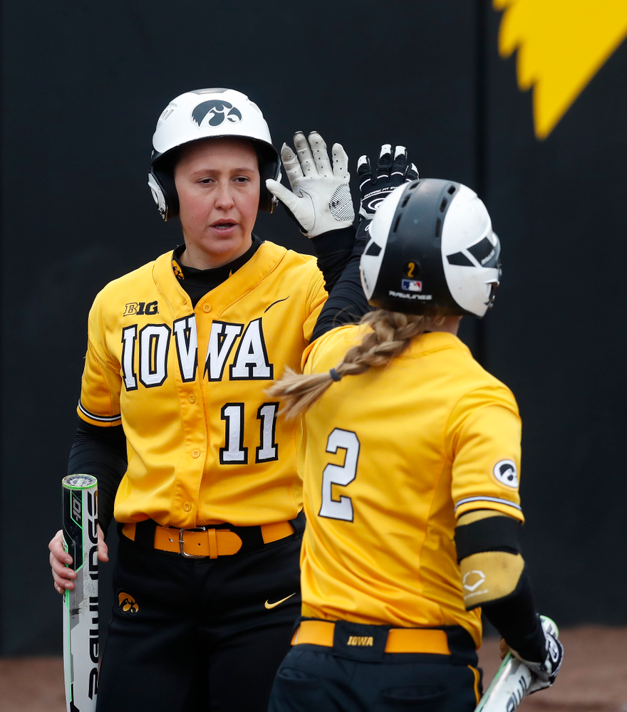 Iowa Hawkeyes starting pitcher/relief pitcher Mallory Kilian (11) and infielder Aralee Bogar (2) against UW Green Bay Tuesday, March 27, 2018 at Bob Pearl Field. (Brian Ray/hawkeyesports.com)