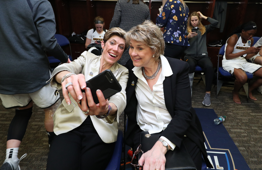 Iowa Hawkeyes head coach Lisa Bluder and associate head coach Jan Jensen take a selfie against the NC State Wolfpack in the regional semi-final of the 2019 NCAA Women's College Basketball Tournament Saturday, March 30, 2019 at Greensboro Coliseum in Greensboro, NC.(Brian Ray/hawkeyesports.com)