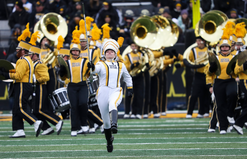 Hawkeye Marching Band drum major Analisa Iole marches onto the field before a game against Northwestern at Kinnick Stadium on November 10, 2018. (Tork Mason/hawkeyesports.com)