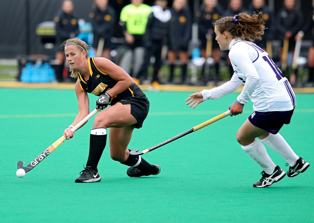Iowa's Sophie Sunderland (20) passes during the fourth quarter of their game at Grant Field in Iowa City on Saturday, Oct 26, 2019. (Stephen Mally/hawkeyesports.com)