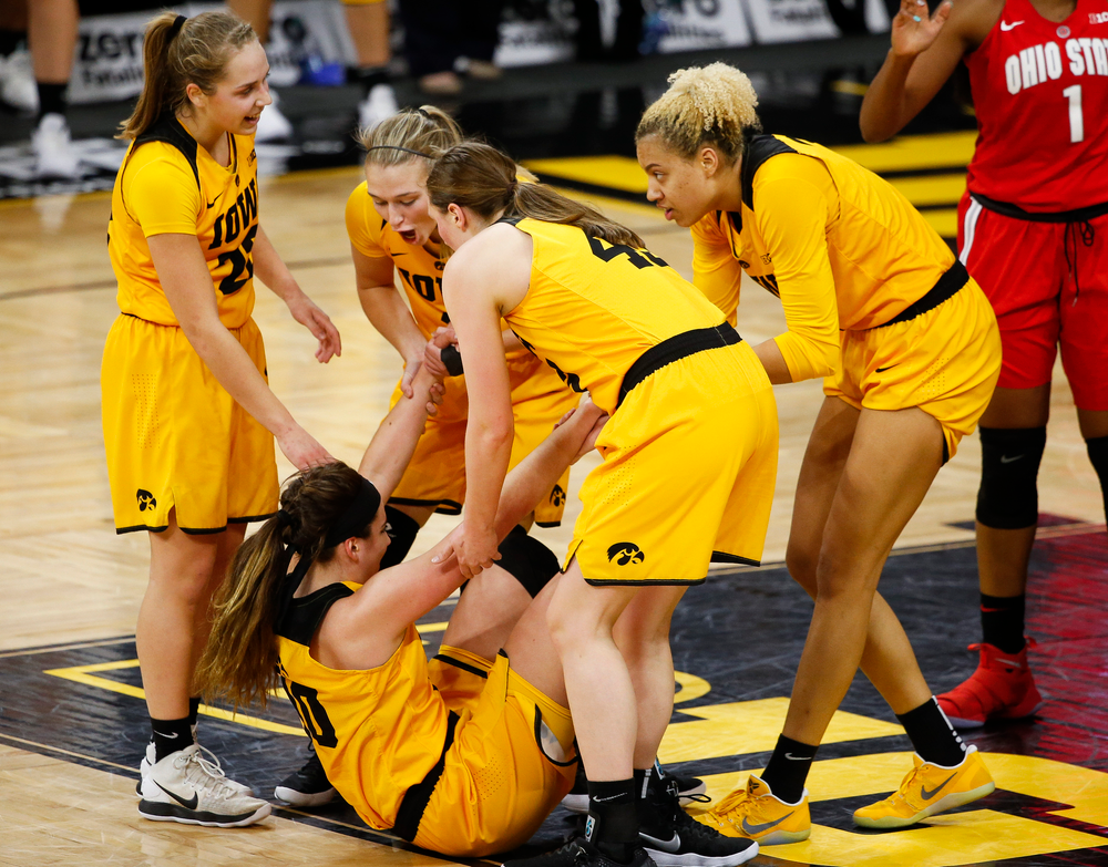 Iowa Hawkeyes forward Megan Gustafson (10) is picked up by her teammates after being fouled during a game against the Ohio State Buckeyes at Carver-Hawkeye Arena on January 25, 2018. (Tork Mason/hawkeyesports.com)