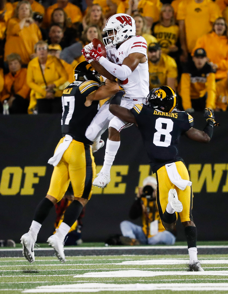 Iowa Hawkeyes defensive back Amani Hooker (27) and Iowa Hawkeyes defensive back Matt Hankins (8) break up a pass during a game against Wisconsin at Kinnick Stadium on September 22, 2018. (Tork Mason/hawkeyesports.com)