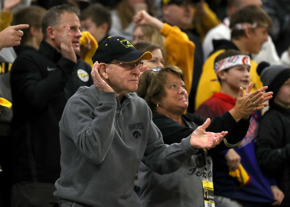 Former Head Coach Dan Gable claps as Iowa's Michael Kemerer wrestles Penn State's Mark Hall at 174 pounds Friday, January 31, 2020 at Carver-Hawkeye Arena. Kemerer won the match 11-6. (Brian Ray/hawkeyesports.com)