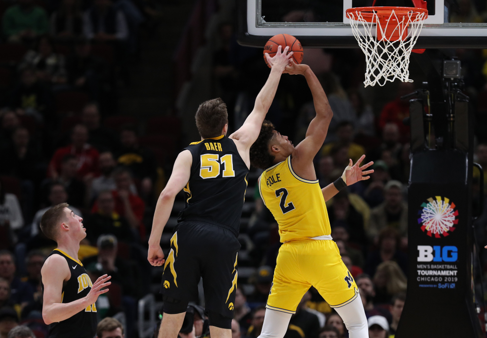 Iowa Hawkeyes forward Nicholas Baer (51) against the Michigan Wolverines in the 2019 Big Ten Men's Basketball Tournament Friday, March 15, 2019 at the United Center in Chicago. (Brian Ray/hawkeyesports.com)