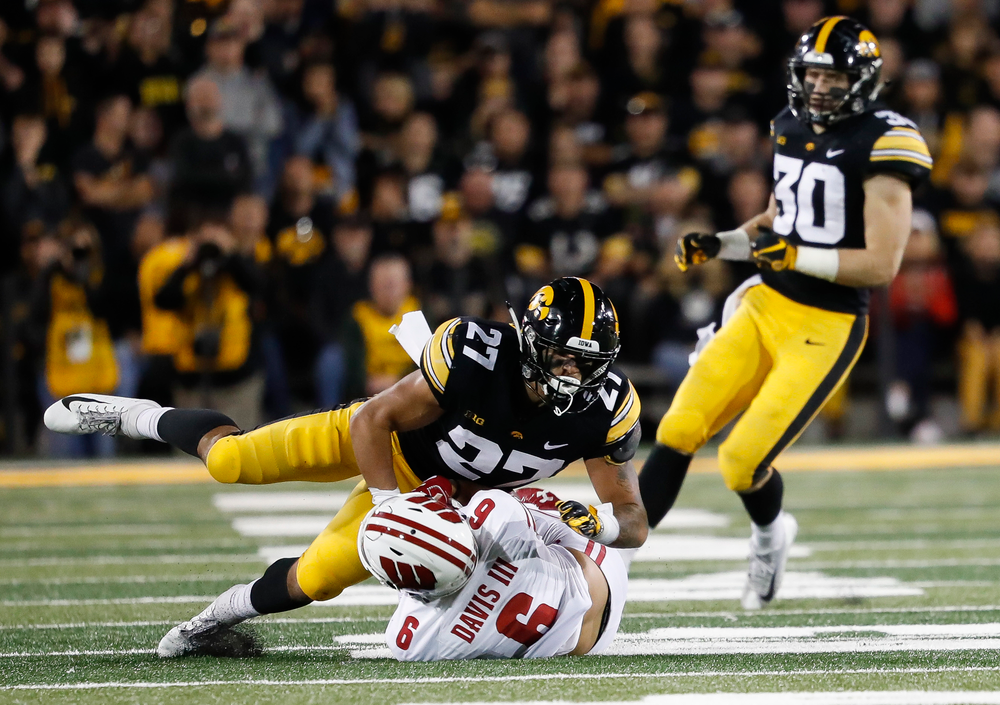 Iowa Hawkeyes defensive back Amani Hooker (27) makes a tackle during a game against Wisconsin at Kinnick Stadium on September 22, 2018. (Tork Mason/hawkeyesports.com)