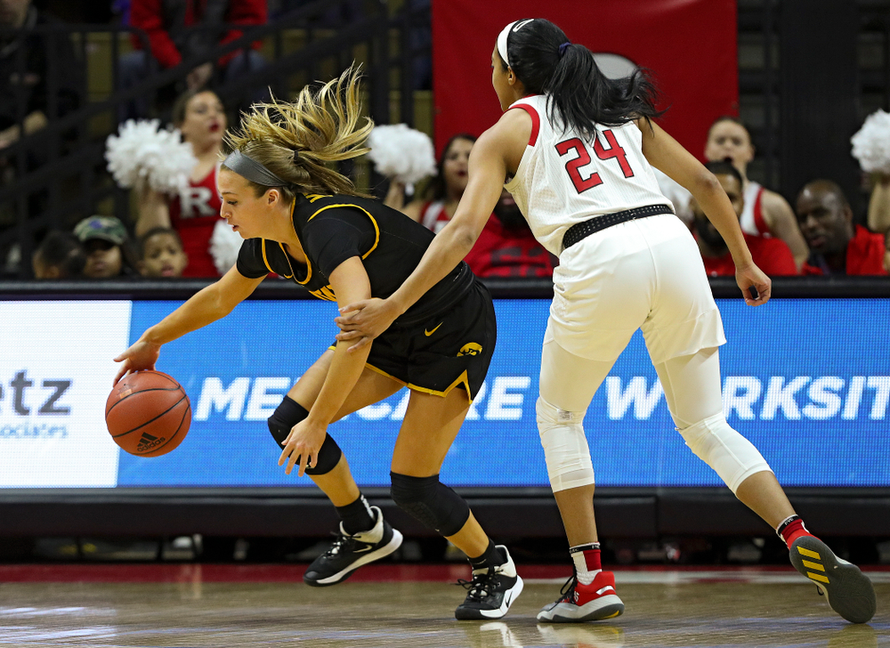 Iowa guard Makenzie Meyer (3) steals the ball away from Rutgers' Arella Guirantes (24) during the first quarter of their game at the Rutgers Athletic Center in Piscataway, N.J. on Sunday, March 1, 2020. (Stephen Mally/hawkeyesports.com)