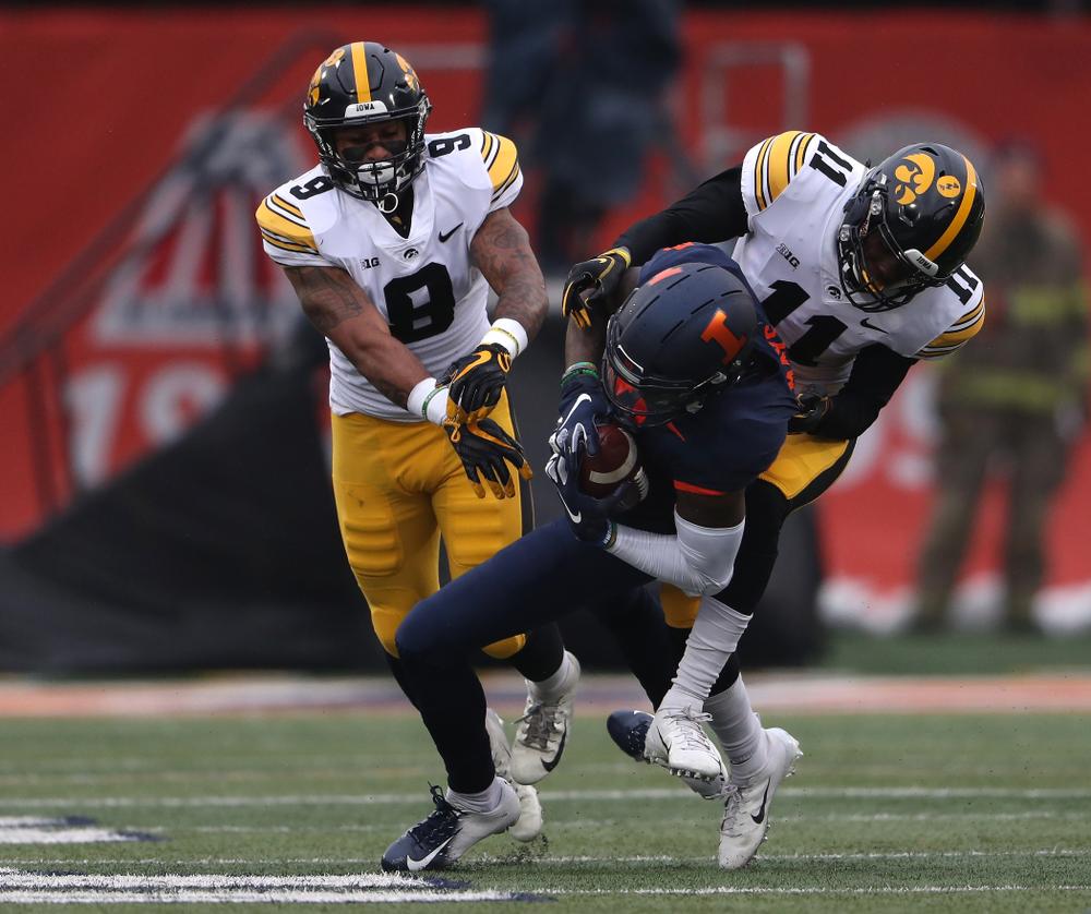 Iowa Hawkeyes defensive back Geno Stone (9) and defensive back Michael Ojemudia (11) against the Illinois Fighting Illini Saturday, November 17, 2018 at Memorial Stadium in Champaign, Ill. (Brian Ray/hawkeyesports.com)