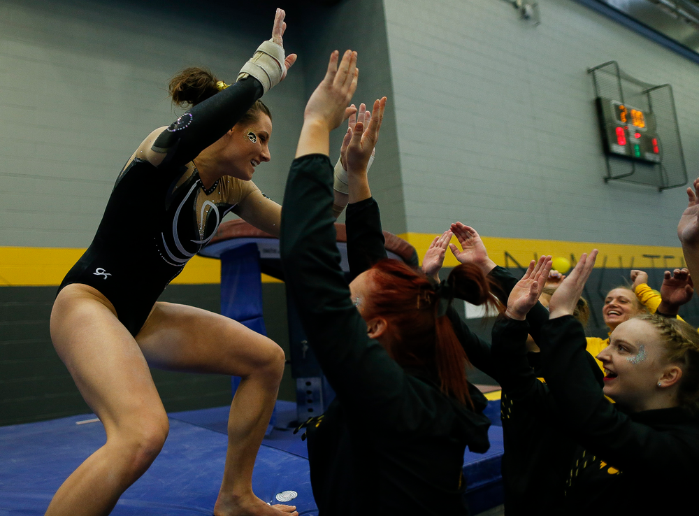 Lanie Snyder celebrates after competing on the vault during the Black and Gold Intrasquad meet at the Field House on 12/2/17. (Tork Mason/hawkeyesports.com)