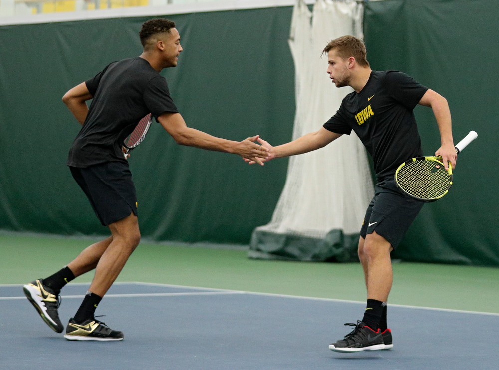 Iowa's Oliver Okonkwo (from left) celebrates with Will Davies during their doubles match at the Hawkeye Tennis and Recreation Complex in Iowa City on Thursday, January 16, 2020. (Stephen Mally/hawkeyesports.com)