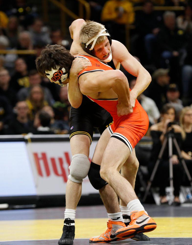 Iowa's Phillip Laux wrestles Oklahoma State's Kaid Brock at 133 pounds