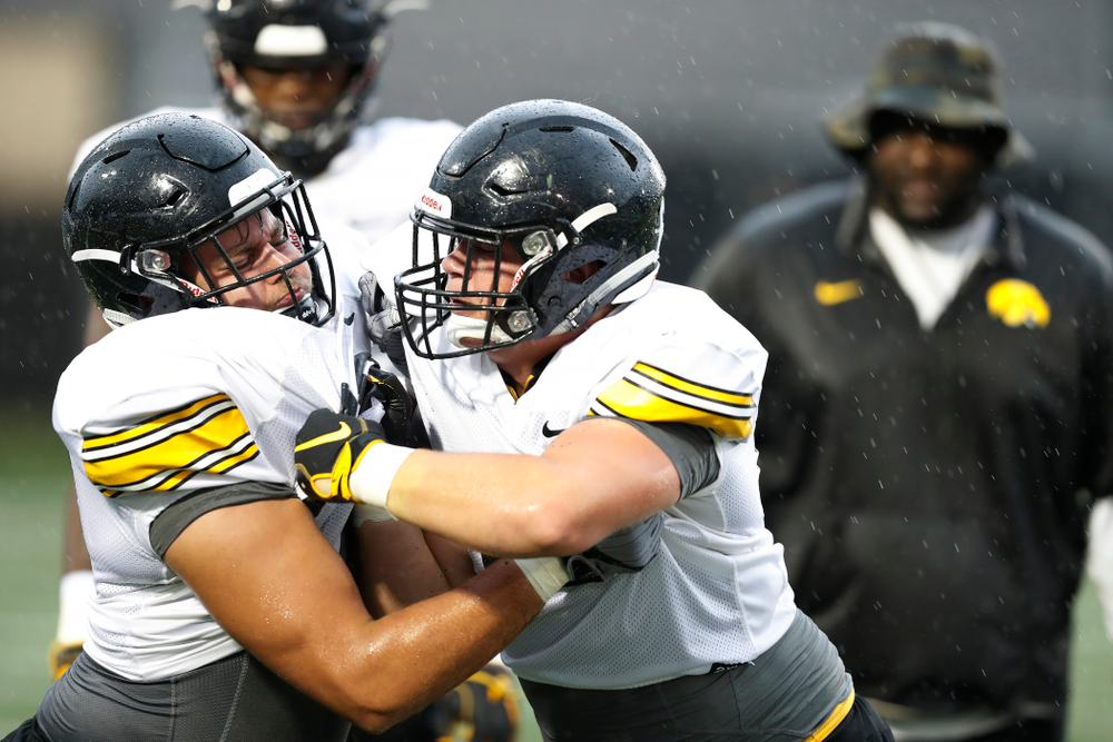 Iowa Hawkeyes defensive end Sam Brincks (90) and defensive lineman Tyler Linderbaum (65) during camp practice No. 15  Monday, August 20, 2018 at the Hansen Football Performance Center. (Brian Ray/hawkeyesports.com)