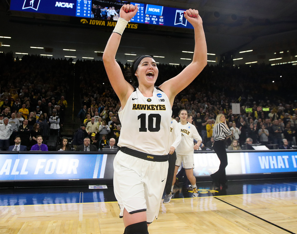 Iowa Hawkeyes center Megan Gustafson (10) runs to center court after winning their second round game in the 2019 NCAA Women's Basketball Tournament at Carver Hawkeye Arena in Iowa City on Sunday, Mar. 24, 2019. (Stephen Mally for hawkeyesports.com)