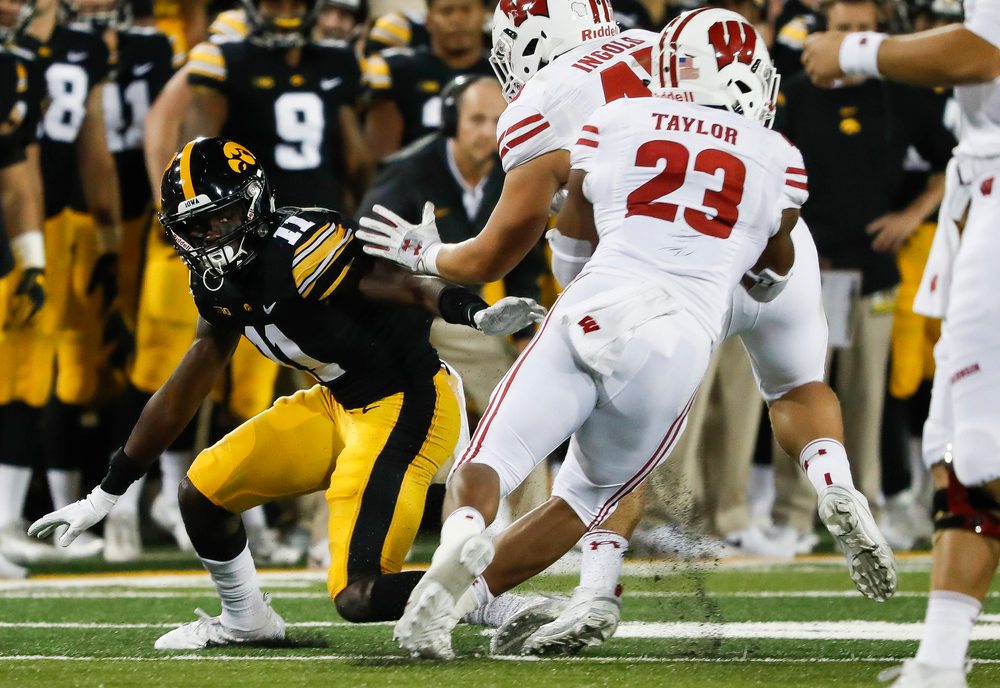 Iowa Hawkeyes defensive back Michael Ojemudia (11) holds the edge during a game against Wisconsin at Kinnick Stadium on September 22, 2018. (Tork Mason/hawkeyesports.com)