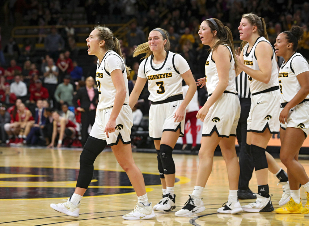 Iowa Hawkeyes guard Kathleen Doyle (22) celebrates with guard Makenzie Meyer (3), guard Mckenna Warnock (14), forward Monika Czinano (25), and guard Alexis Sevillian (5) after making a basket while being fouled during the fourth quarter of their game at Carver-Hawkeye Arena in Iowa City on Sunday, January 12, 2020. (Stephen Mally/hawkeyesports.com)