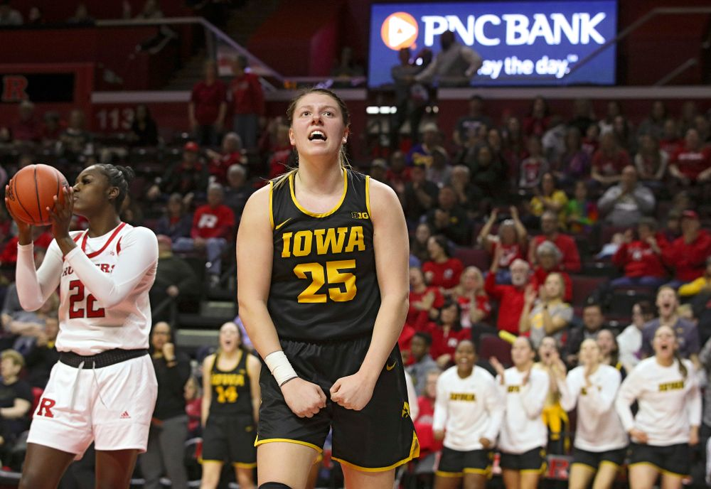 Iowa forward/center Monika Czinano (25) celebrates after making a basket while being fouled during the fourth quarter of their game at the Rutgers Athletic Center in Piscataway, N.J. on Sunday, March 1, 2020. (Stephen Mally/hawkeyesports.com)