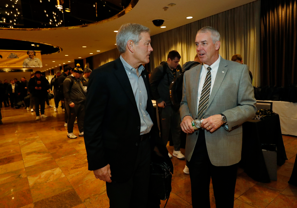 Iowa Hawkeyes head coach Kirk Ferentz and Henry B. and Patricia B. Tippie Director of Athletics Chair Gary Barta