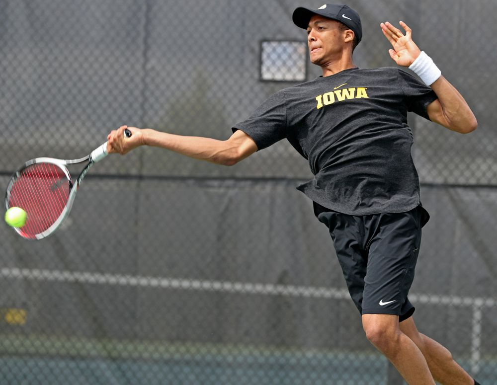 Iowa's Oliver Okonkwo competes during a match against Ohio State at the Hawkeye Tennis and Recreation Complex in Iowa City on Sunday, Apr. 7, 2019. (Stephen Mally/hawkeyesports.com)