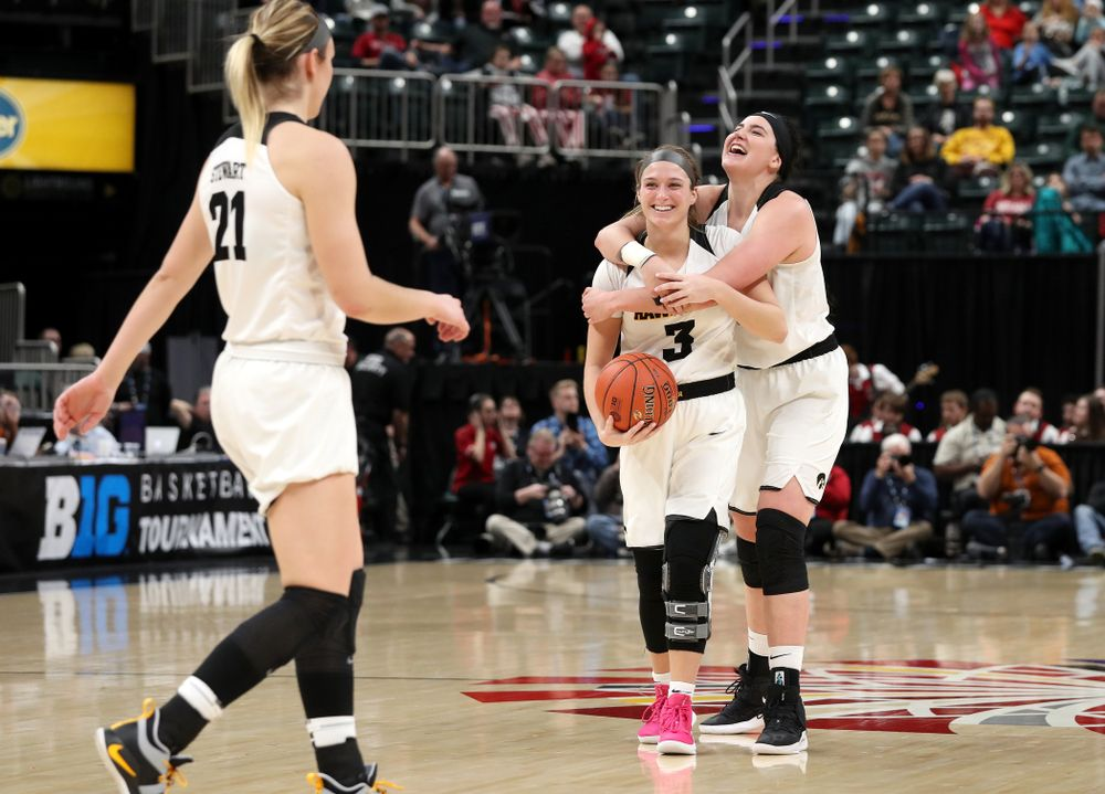 Iowa Hawkeyes guard Makenzie Meyer (3) and forward Megan Gustafson (10) celebrate against the Indiana Hoosiers in the quarterfinals of the Big Ten Tournament Friday, March 8, 2019 at Bankers Life Fieldhouse in Indianapolis, Ind. (Brian Ray/hawkeyesports.com)