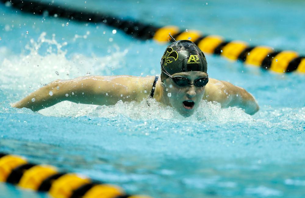 Kelly McNamara swims the 100 yard butterfly
