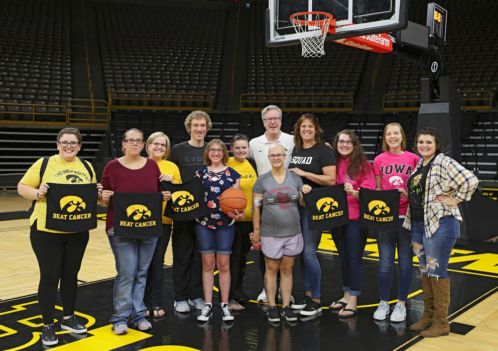 Iowa Hawkeyes head coach Fran McCaffery and Margaret McCaffery take pictures with visitors from the University of Iowa Hospitals and Clinics Adolescent and Young Adult (AYA) Cancer Program after practice at Carver-Hawkeye Arena in Iowa City on Monday, Sep 30, 2019. (Stephen Mally/hawkeyesports.com)